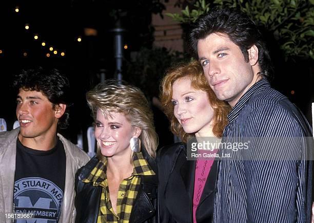 Singer/Actress Olivia NewtonJohn boyfriend Matt Lattanzi actress Marilu Henner and actor John Travolta on November 28 1983 dine at The Ivy in West...