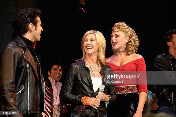 Singer/actress Olivia NewtonJohn visits the Broadway cast of 'Grease' to promote Breast Cancer Awareness Month with Derek Keeling and Ashley Spencer...