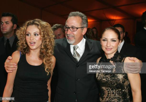 Singer/actress Paulina Rubio poses with Emilio and Gloria Estefan at the City of Hope Spirit of Life Gala on November 18 2004 in South Beach Florida