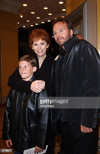"""Singer-actress Reba McEntire and husband and son attend the premiere of the film """"Shallow Hal"""" November 1, 2001 in Los Angeles, CA."""