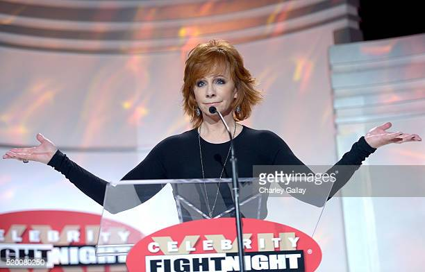 Singer/actress Reba McEntire speaks onstage during Muhammad Ali's Celebrity Fight Night XXII at the JW Marriott Phoenix Desert Ridge Resort & Spa on...