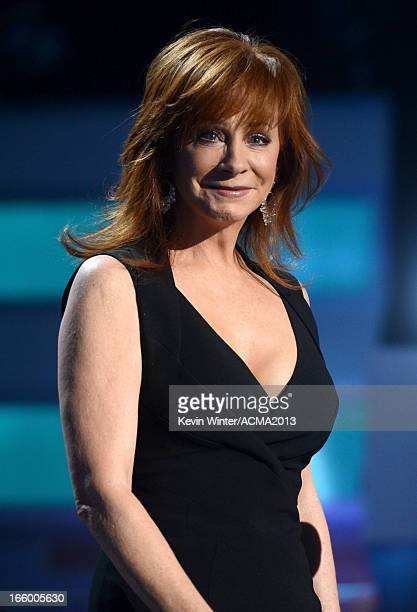 Singer/actress Reba McEntire speaks onstage during the 48th Annual Academy of Country Music Awards at the MGM Grand Garden Arena on April 7 2013 in...