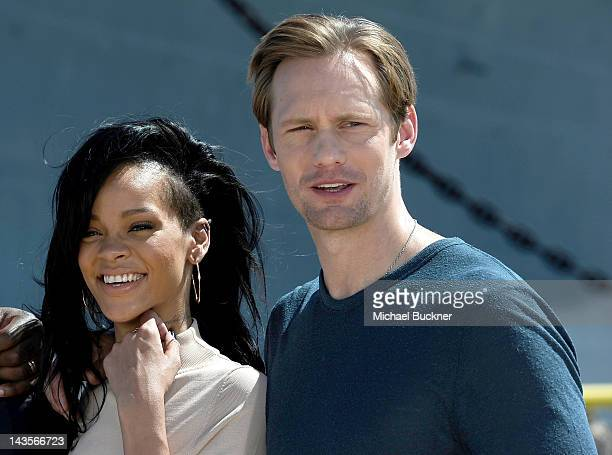 Singer/Actress Rihanna and actor Alexander Skarsgard attend the Battleship Photo Call at the Battleship Missouri Memorial on April 28 2012 in Pearl...