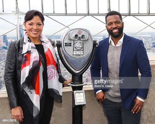 Singer/actress Sara Ramirez and author/comedian Baratunde Thurston visit The Empire State Building in celebration of 'Ted Talks Live' on November 2...