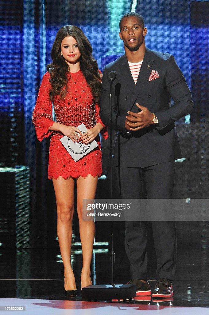 Singer/Actress Selena Gomez and NFL player Victor Cruz present Best Breakthrough Athlete onstage at the 2013 ESPY Awards at Nokia Theatre L.A. Live on July 17, 2013 in Los Angeles, California.