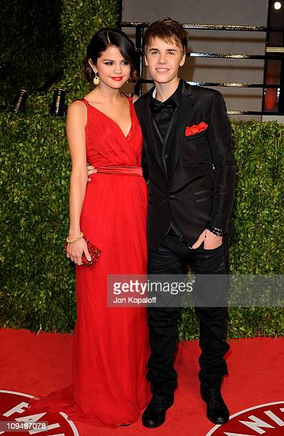 Singer/actress Selena Gomez and singer Justin Bieber arrive at the Vanity Fair Oscar Party at Sunset Tower on February 27 2011 in West Hollywood...