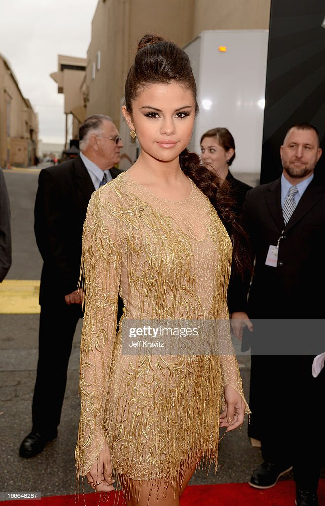 Singer/actress Selena Gomez attends the 2013 MTV Movie Awards at Sony Pictures Studios on April 14, 2013 in Culver City, California.