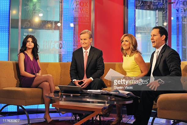 Singer/actress Selena Gomez talks to hosts Steve Doocy Alisyn Camerota and Brian Kilmeade at 'FOX Friends' at FOX Studios on June 29 2011 in New York...