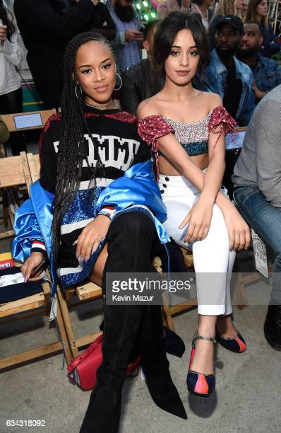 Singer/actress Serayah McNeill and singer Camila Cabello at the TommyLand Tommy Hilfiger Spring 2017 Fashion Show on February 8 2017 in Venice...