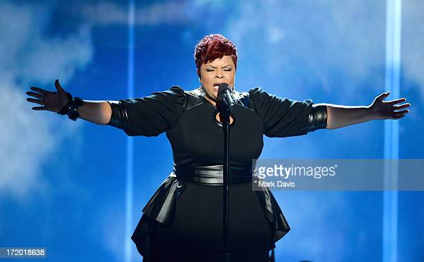 Singer/actress Tamela Mann performs onstage during the 2013 BET Awards at Nokia Theatre LA Live on June 30 2013 in Los Angeles California