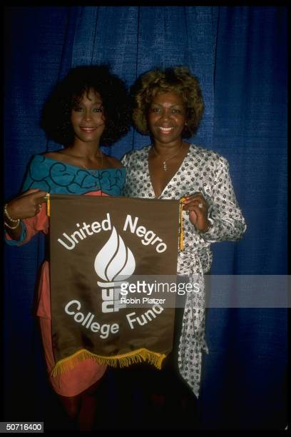 Singer/actress Whitney Houston and w. Mother Cissy as a spokesperson for the United Negro College Fund.