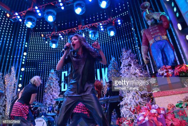 Singer/actress Zendaya performs at AMP Radio's Toys For Teens drive at 5 Towers Outdoor Concert Arena on December 17 2013 in Universal City California
