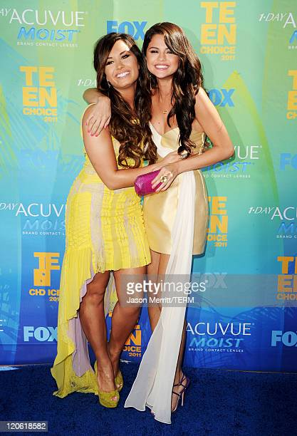 Singer/actresses Demi Lovato and Selena Gomez arrive at the 2011 Teen Choice Awards held at the Gibson Amphitheatre on August 7, 2011 in Universal...