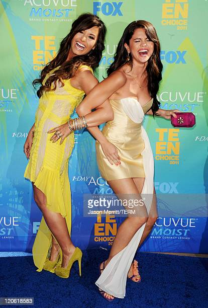 Singer/actresses Demi Lovato and Selena Gomez arrive at the 2011 Teen Choice Awards held at the Gibson Amphitheatre on August 7 2011 in Universal...