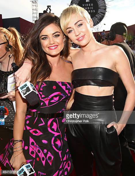 Singer/actresses Lucy Hale and Miley Cyrus attend the 2014 MTV Video Music Awards at The Forum on August 24, 2014 in Inglewood, California.