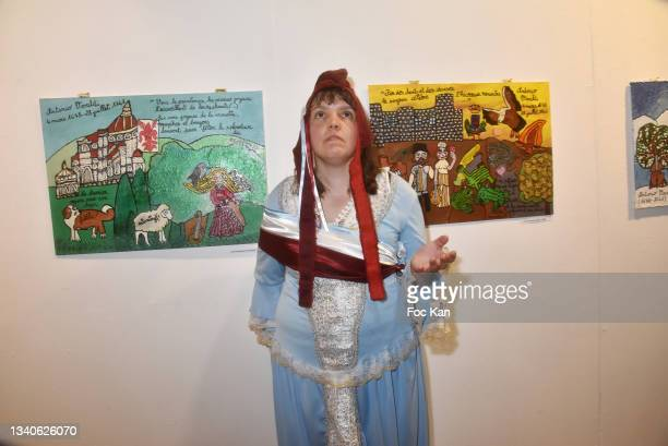 """Singer/actress/painter Candy Ming poses with her work during """"Le Cinema De Benoit Delepine Et Gustave Kervern"""" Book Signing Party At Halle Saint..."""