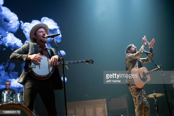 Singer/banjo player Scott Avett and singer/guitarist Seth Avett of the Avett Brothers perform at Bojangles Coliseum on December 31 2018 in Charlotte...
