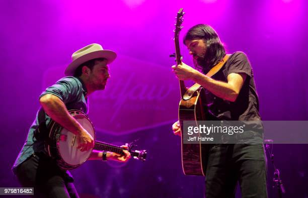 Singer/banjo player Scott Avett and singer/guitarist Seth Avett of The Avett Brothers peform at PNC Music Pavilion on June 20 2018 in Charlotte North...