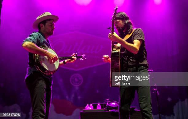 Singer/banjo player Scott Avett and singer/guitarist Seth Avett of The Avett Brothers peform at PNC Music Pavilion on June 20 2018 in Charlotte North...