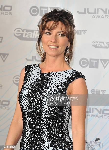 Singer/Canadian music Hall of Fame Inductee Shania Twain poses on the red carpet at the 2011 Juno Awards at the Air Canada Centre on March 27 2011 in...