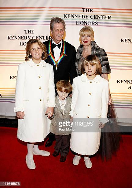 Singercomposer Brian Wilson Kennedy Center Honors recipient with his wife Melinda Ledbetter and children Daria Dylan and Delanie pose for the cameras...