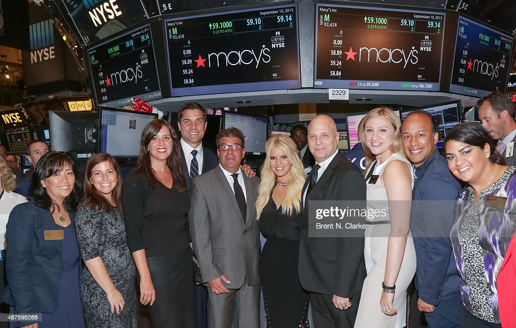 Jessica Simpson And Mike Gansmoe Ring The New York Stock Exchange Opening Bell : News Photo