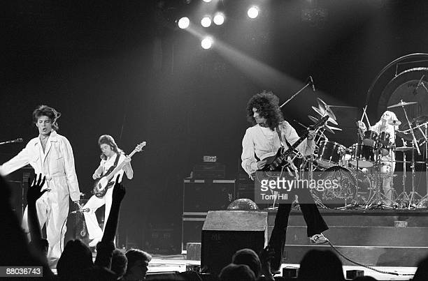 Freddie Mercury John Deacon Brian May and Roger Taylor of Queen performing at the Omni