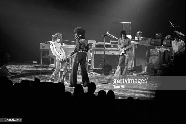 Singer-frontman Mick Jagger, keyboardist Billy Preston, guitarist Ronnie Wood and guitarist Keith Richards perform with The Rolling Stones at the...