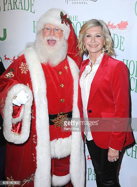 Singer/Grand Marshal Olivia Newton-John and Santa Claus attend the 85th Annual Hollywood Christmas Parade on November 27, 2016 in Hollywood,...