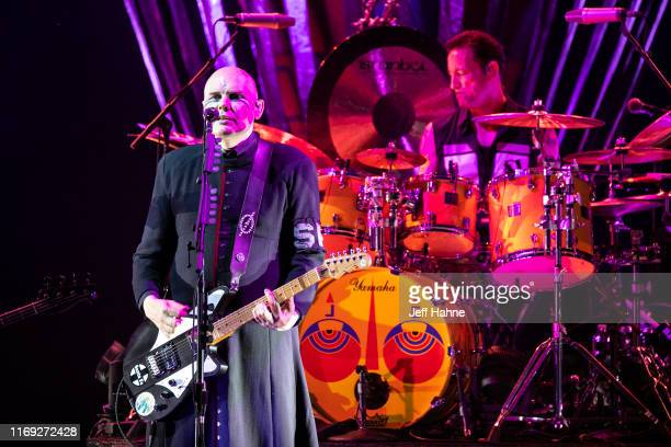 Singer/guitarist Billy Corgan and drummer Jimmy Chamberlain of Smashing Pumpkins perform at PNC Music Pavilion on August 20 2019 in Charlotte North...
