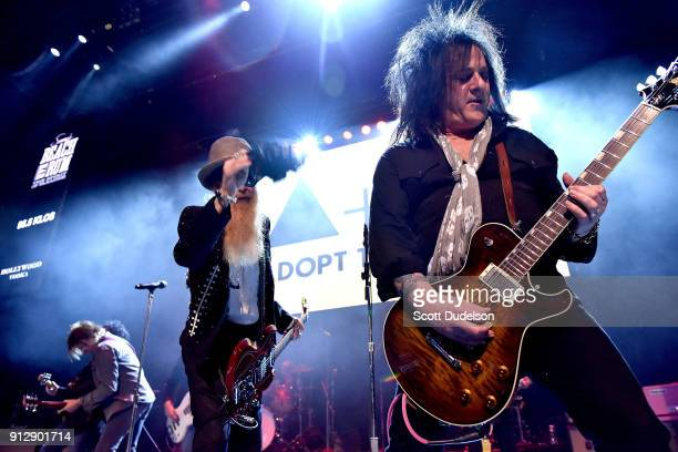 Singer/guitarist Billy Gibbons of the band ZZ Top and guitarist Steve Stevens perform onstage with Kings of Chaos during the Adopt The Arts annual...