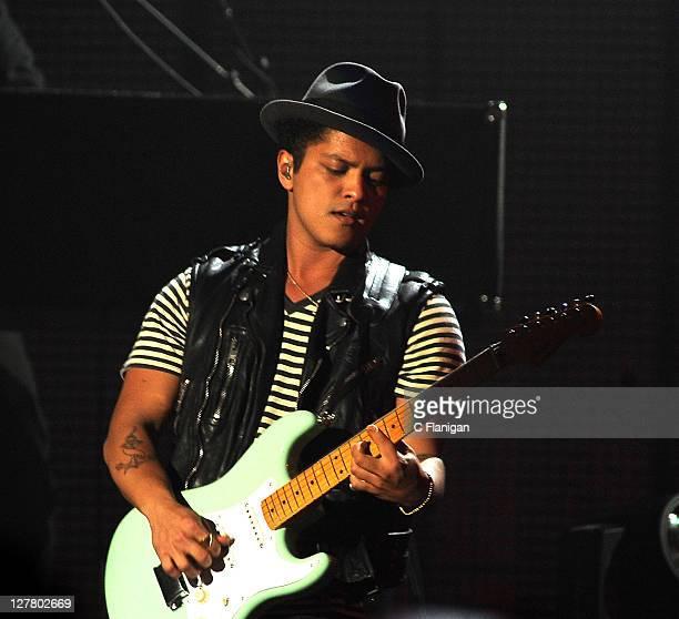 Singer/guitarist Bruno Mars performs during the Hooligans in Wondaland Tour at Bill Graham Civic Auditorium on June 8 2011 in San Francisco California