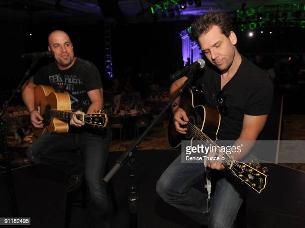 Singer/guitarist Chris Daughtry and comedian/actor Dane Cook rehearse for the 14th annual Andre Agassi Foundation for Education's Grand Slam for...