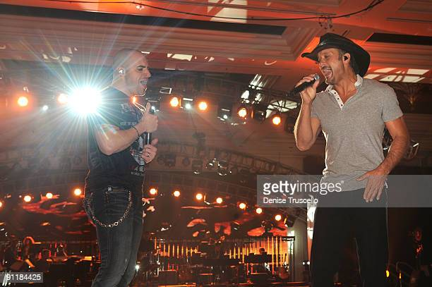 Singer/guitarist Chris Daughtry of the group Daughtry and recording artist Tim McGraw rehearse for the 14th annual Andre Agassi Foundation for...