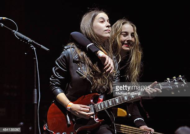 Singer/guitarist Danielle Haim and bassist Este Haim of HAIM perform during Day 2 of FYF Fest 2014 at LA Sports Arena Exposition Park on August 24...