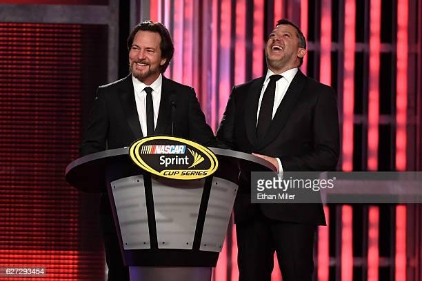 Singer/guitarist Eddie Vedder of Pearl Jam and NASCAR Sprint Cup Series driver Tony Stewart speak onstage during the 2016 NASCAR Sprint Cup Series...