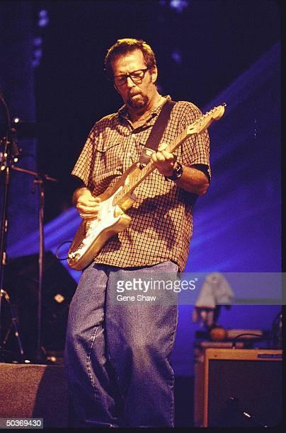 Singer/guitarist Eric Clapton performing on stage