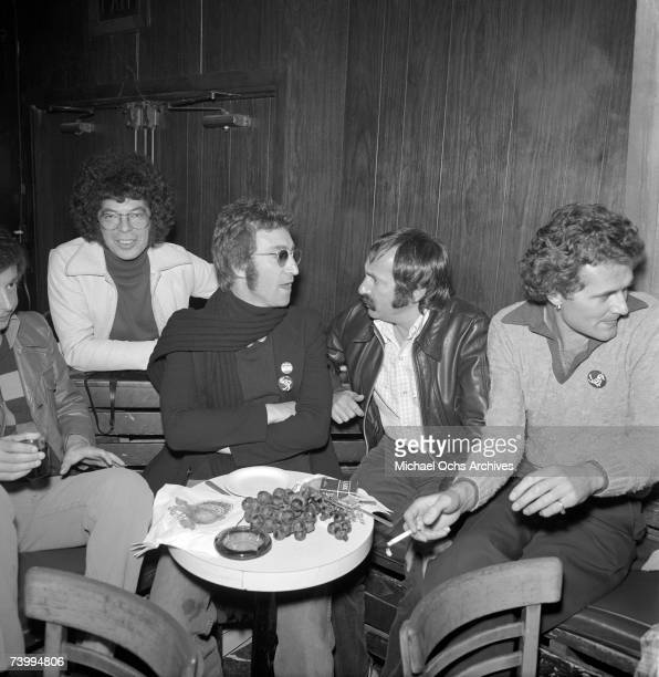 Singerguitarist John Lennon formerly of The Beatles and guests celebrate an early Thanksgiving at The Troubadour during Lennon's 'Lost Weekend'...