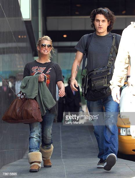 Singer/guitarist John Mayer and actress/singer Jessica Simpson leave the Four Seasons Hotel on January 23, 2007 in Miami, Florida.
