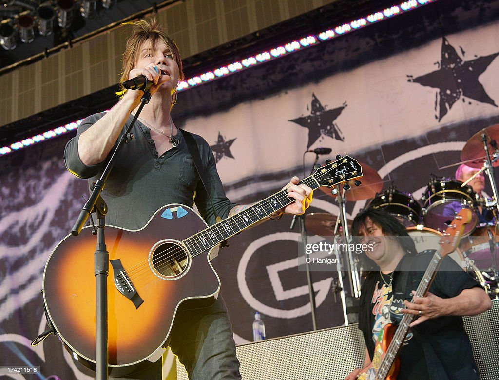 Singer/Guitarist John Rzeznik and Bassist Robby Takac of The Goo Goo Dolls perform during the California Mid-State Fair on July 21, 2013 in Paso Robles, California.