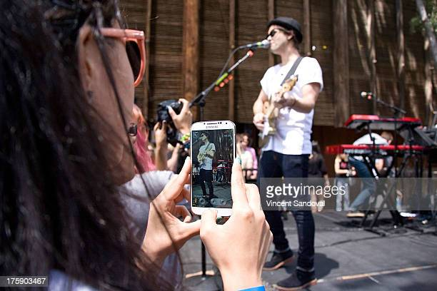 Singer/guitarist Keith Jeffery of Atlas Genius performs at the WBR Summer Sessions at Warner Bros Records boutique store on August 9 2013 in Burbank...