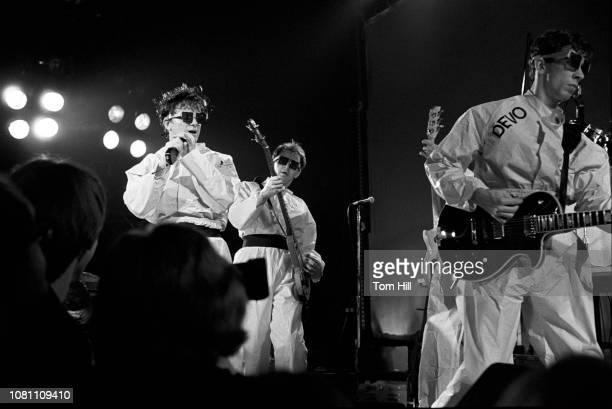 Singerguitarist Mark Mothersbaugh bassist Gerald Casale and guitarist Bob Mothersbaugh of Devo perform at The Agora Ballroom on July 27 1979 in...