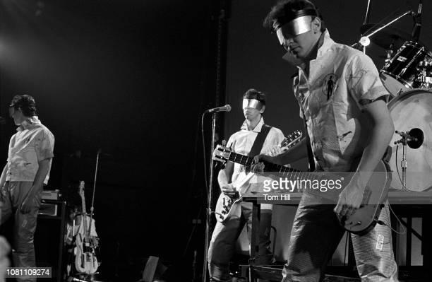 Singerguitarist Mark Mothersbaugh guitaristkeyboardist Bob Casale and bassist Gerald Casale of Devo perform at The Agora Ballroom on July 27 1979 in...