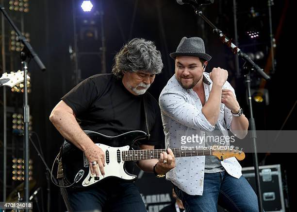 Singer/guitarist Randy Owen of Alabama and frontman Mike Eli of the Eli Young Band rehearse onstage during ACM Presents Superstar Duets at Globe Life...