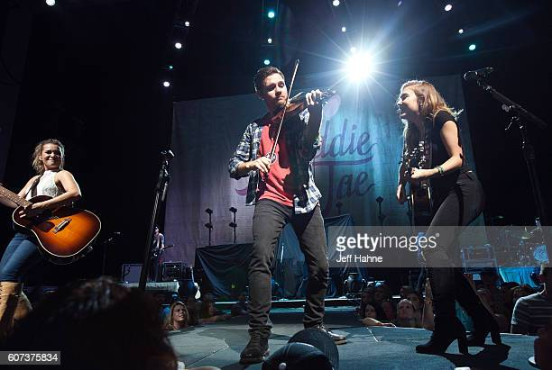 Singer/guitarist Tae Dye and singer/guitarist Maddie Marlow of Maddie Tae perform at PNC Music Pavilion on September 17 2016 in Charlotte North...