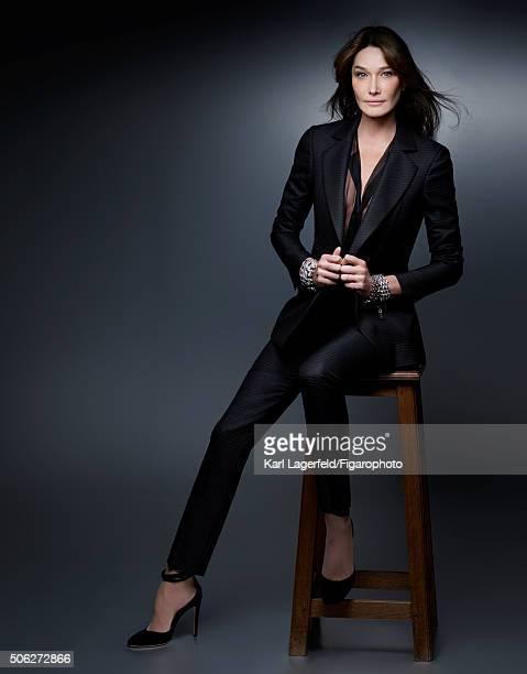 Singer/model Carla Bruni is photographed for Madame Figaro on November 18 2015 in Paris France Suit and shirt bracelets shoes PUBLISHED IMAGE CREDIT...