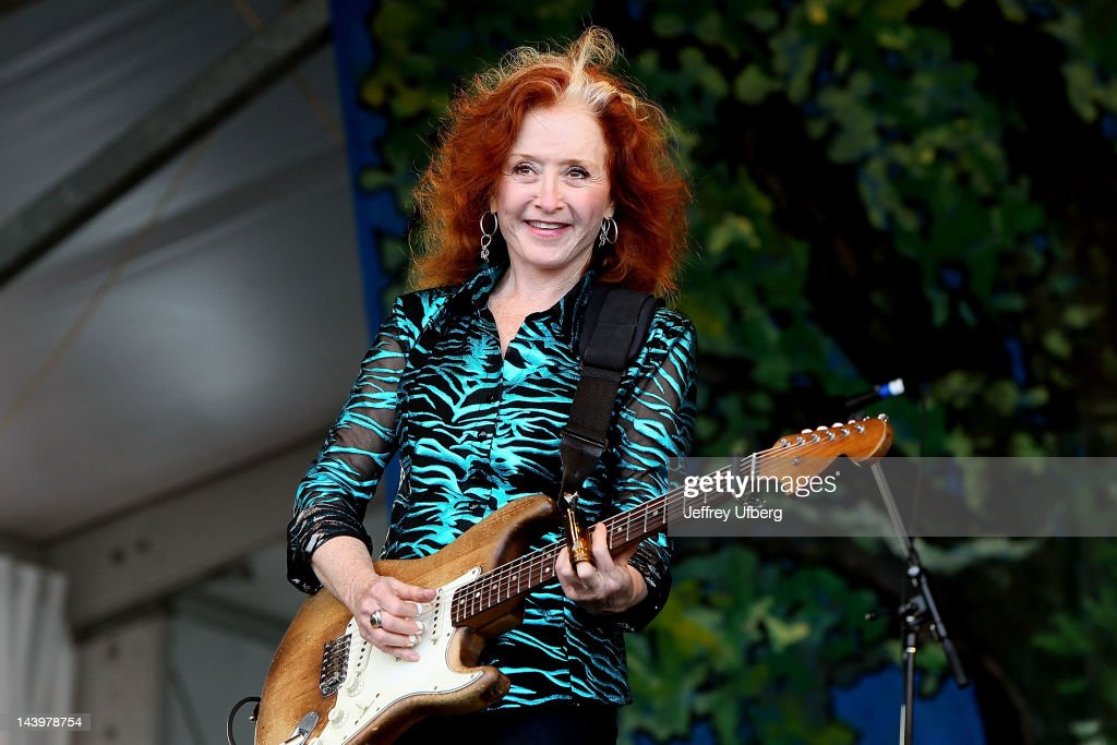 Singer/musician Bonnie Raitt performs with the Preservation Hall Jazz Band during the 2012 New Orleans Jazz & Heritage Festival at the Fair Grounds Race Course on May 6, 2012 in New Orleans, Louisiana.