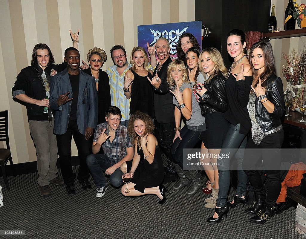 Singer/musician Dee Snider (C) poses with the cast of 'Rock of Ages' at the after party for Dee Snider's Broadway debut in 'Rock of Ages' at The Glass House Tavern on October 11, 2010 in New York City.