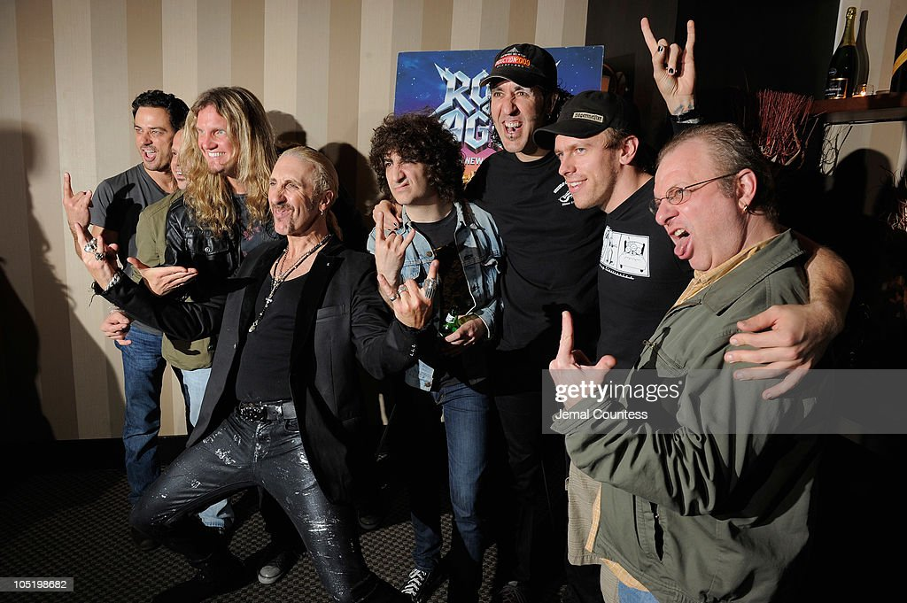 Singer/musician Dee Snider (C) poses with the 'Rock of Ages' band at the after party for Dee Snider's Broadway debut in 'Rock of Ages' at The Glass House Tavern on October 11, 2010 in New York City.
