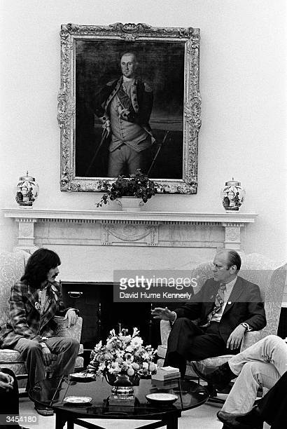 Singer/musician George Harrison and President Gerald R Ford sit down to talk in the White House December 13 1974 Harrison was a guest of the...